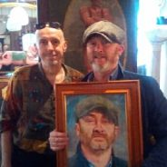 Handing over Drew Pritchards portrait.